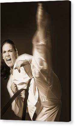 Woman Performing Martial Arts Canvas Print by Don Hammond