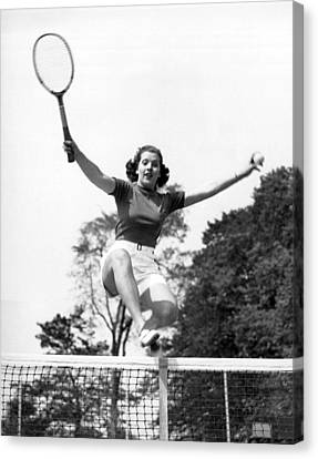 Woman Player Leaping Over Net Canvas Print by Underwood Archives