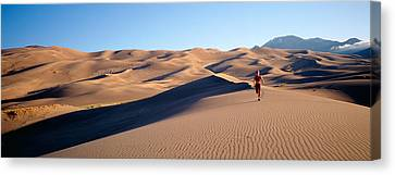 Jogging Canvas Print - Woman Running In The Desert, Great Sand by Panoramic Images
