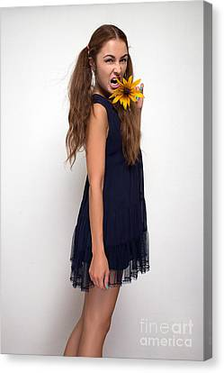Woman Screaming With Yellow Flower Canvas Print by Aleksey Tugolukov