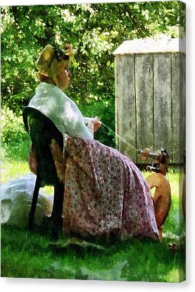 Woman Spinning Wool Canvas Print by Susan Savad