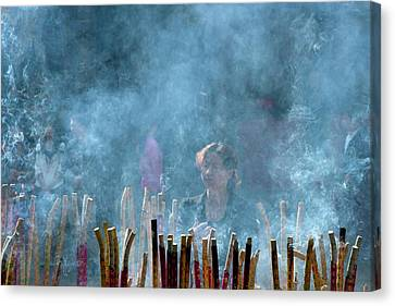 Woman Standing In Front Of Incense Burner Canvas Print by Tony Camacho