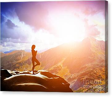 Woman Standing In Tree Yoga Position Meditating In Mountains At Sunset Canvas Print by Michal Bednarek
