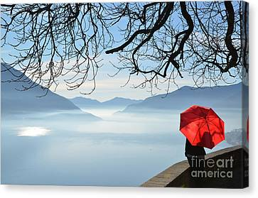 Woman Standing With A Red Umbrella Canvas Print by Mats Silvan