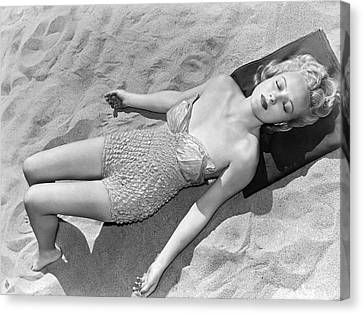 Woman Sun Bathing At The Beach Canvas Print by Underwood Archives