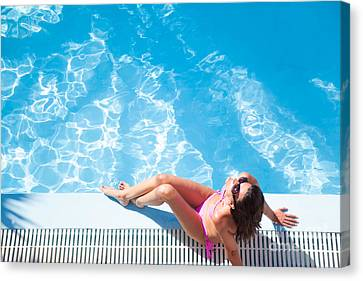 Woman Sunbathing By The Swimming Pool Canvas Print