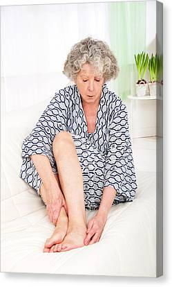 Woman Touching Her Ankle Canvas Print