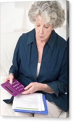 Woman Using Calculator Canvas Print