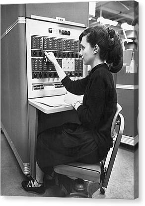 Concentration Canvas Print - Woman Using Ibm 650 Computer by Underwood Archives