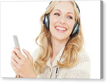 Woman Wearing Headphones With Smartphone Canvas Print by Ian Hooton
