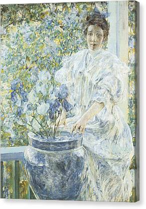 Woman With A Vase Of Irises Canvas Print by Robert Reid