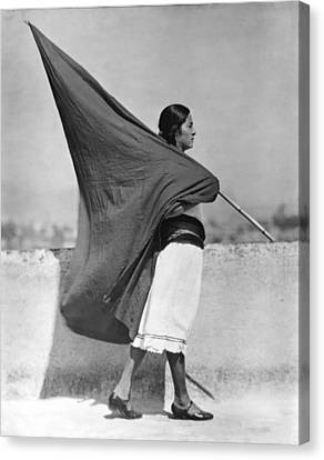 Woman With Flag, Mexico City, 1928 Canvas Print by Tina Modotti