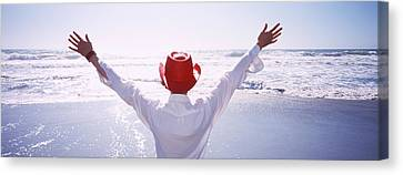 Woman With Outstretched Arms On Beach Canvas Print by Panoramic Images