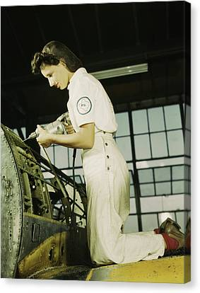 Woman Working With A Rivet Gun On Part Canvas Print