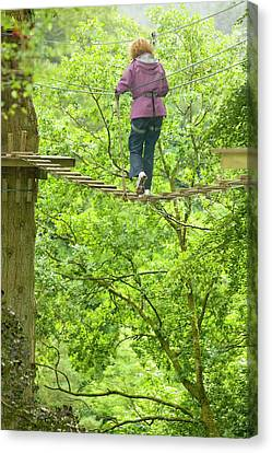 Women On Aerial Walkway Canvas Print by Ashley Cooper