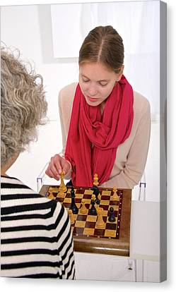 Women Playing Chess Canvas Print by Lea Paterson