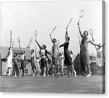 Racquet Canvas Print - Women Practicing Tennis by Underwood Archives