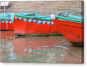 Wooden Boats In Ganges River, Varanasi Canvas Print by Ali Kabas