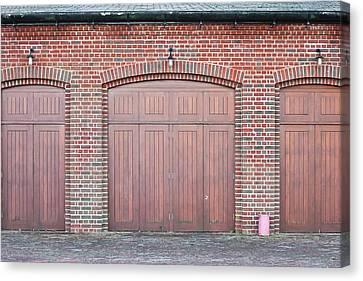 Wooden Doors Canvas Print by Tom Gowanlock