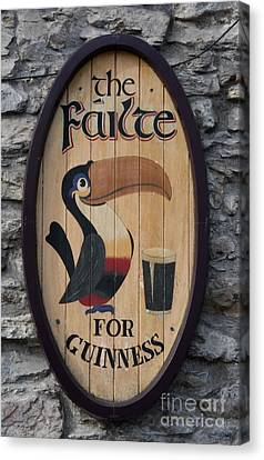 Wooden Guinness Sign Canvas Print by Christiane Schulze Art And Photography