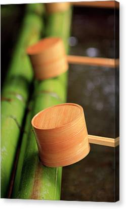 Wooden Ladles Are Placed Canvas Print by Paul Dymond