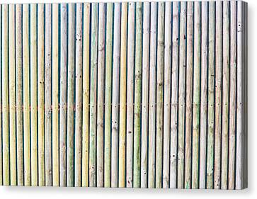 Wooden Poles Canvas Print by Tom Gowanlock