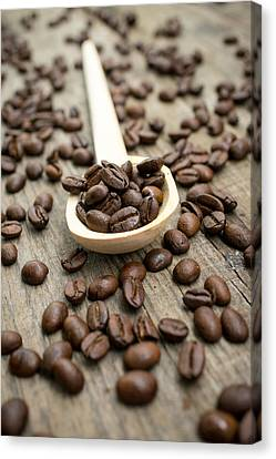 Wooden Spoon With Coffee Beans Canvas Print by Aged Pixel