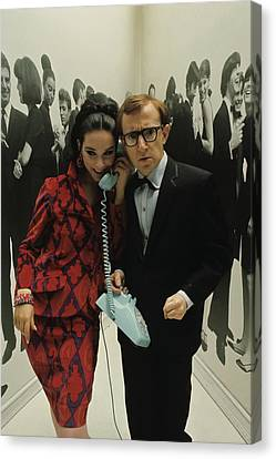 Woody Allen Posing With A Model Holding Canvas Print