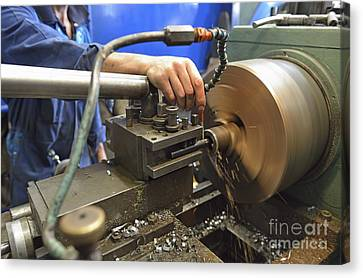 Worker At Factory Checking A Milling Cutter Canvas Print by Sami Sarkis