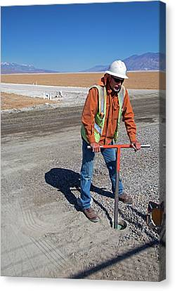 Worker Digging A Bore Hole Canvas Print