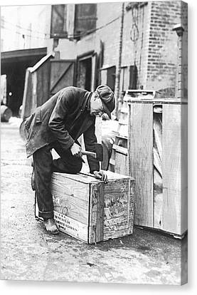 Concentration Canvas Print - Worker Nailing Boxes by Underwood Archives