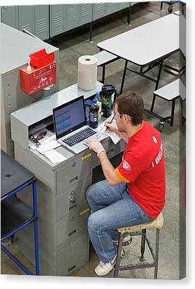 Auto Jobs Canvas Print - Worker Using Laptop In A Factory by Jim West