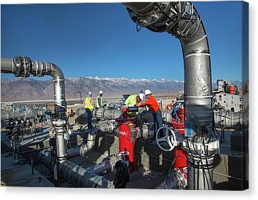 Workers Inspecting Water Pumps Canvas Print