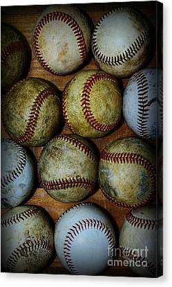 Worn Out Baseballs Canvas Print by Paul Ward