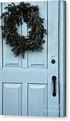 Wreath On Old Blue Door Canvas Print by Birgit Tyrrell