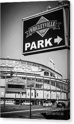 Wrigleyville Sign And Wrigley Field In Black And White Canvas Print by Paul Velgos