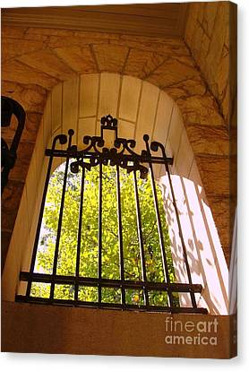 Canvas Print featuring the photograph Wrought Iron Arch Window by Becky Lupe