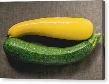 Yellow And Green Courgettes On Brown Fabric Background Canvas Print