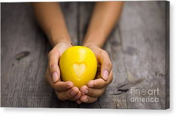 Yellow Apple With Engraved Heart Canvas Print by Aged Pixel