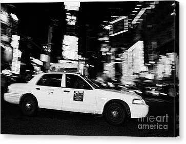 Yellow Cab At Speed In The Middle Of Times Square New York City At Night Canvas Print by Joe Fox