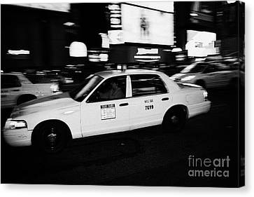 Yellow Cab In Times Square At Night New York City Canvas Print by Joe Fox