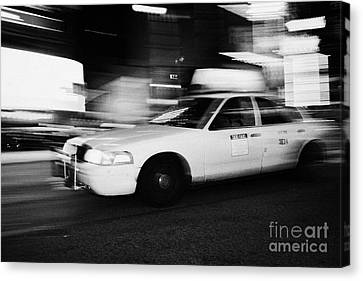 Manhatan Canvas Print - Yellow Cab In Times Square At Night New York City Taxi by Joe Fox