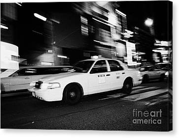 Yellow Cab New York City At Night Canvas Print by Joe Fox
