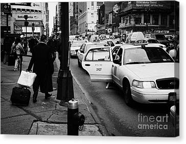Yellow Cab On Taxi Rank Outside Madison Square Garden On 7th Avenue New York City Usa Canvas Print by Joe Fox