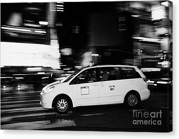 Yellow Cab Speeding Across Crosswalk In Times Square At Night New York City Canvas Print by Joe Fox