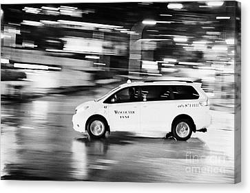 yellow cab taxi downtown Vancouver city at night BC Canada deliberate motion blur Canvas Print by Joe Fox