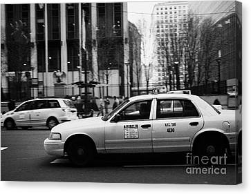 Yellow Cabs Blur Past Madison Square Garden On 7th Avenue New York City Usa Canvas Print by Joe Fox