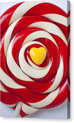 Yellow Candy Heart On Sucker Canvas Print by Garry Gay