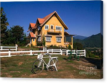 Canvas Print featuring the photograph Yellow Classic House On Hill by Tosporn Preede