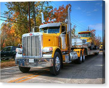 Yellow Eighteen-wheelers Canvas Print by Ester  Rogers